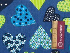 0,5 m Baumwolldruck bunte Herzen auf blau von trotzknopf auf DaWanda.com