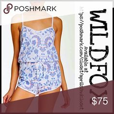 """WILDFOX ROMPER PLAYSUIT 💟NEW WITH TAGS💟 Retail:$88  WILDFOX Terry Romper  * Adjustable thin straps & V-neck front  * White trim detail; Cutout back w/self tie    * A stretch-to-fit and pull-on style  * It measures about 30"""" long, w/a approx. 1.5"""" inseam  * Allover paisley print w/a subtly &purposely 'washed' look  Fabric: 100% Rayon  Color: Multi Item: Pastel lilac  🚫No Trades🚫 ✅ Offers Considered*✅  *Please use the blue 'offer' button to submit an offer. Wildfox Dresses Mini"""
