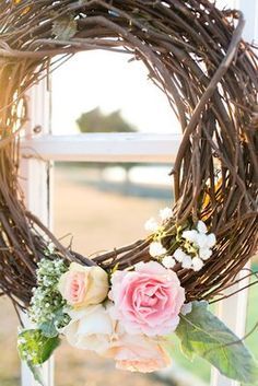 A branch wreath—awesome rustic wedding decor idea (Photo by Allison Davis Photography)