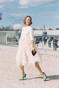 PSW SS 2013....Ulyana Sergeenko wearing unexpected pop of teal satin colored shoes with the feathered coat confection.