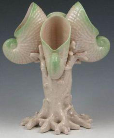pottery & porcelain, Ireland, An [Irish] Belleek [porcelain] Victoria vase,[four shells]. Green tint. Marked with black 1st Mark (1863 to 1890)