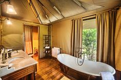 Sand River Masai Mara tent comes complete with a full hot tub for a soak after a day chasing the big five animals