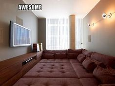 Since my husband is determined to have a movie room... Maybe this is the solution: The floor is all bed!