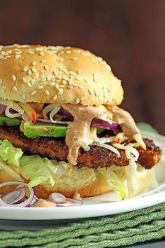 Pork schnitzel and chipotle sandwiches - with pork chops, chipotle chiles, sour cream, lettuce, avocado, lemon juice,  red onion and queso añejo cheese