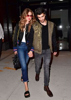 Gigi and Zayn are back at it again looking happier than ever and equally in tune style-wise—AKA wearing matching bomber jackets and distressed denim.