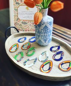 In love with these fresh Spring tones. Did you know each pair of Maasai Earrings is completely unique, made just for you by the Maasai tribe in Kenya? Grab your own unique pair -- @annakram12