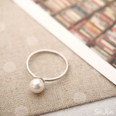 Simple pearl ring, $10, really love all her stuff on Etsy. @Jessica Watterworth look it's another pearl ring!