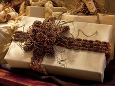 Bring the outdoors in with this stylish (and free!) pinecone ribbon and bow.  http://www.hgtv.com/handmade/25-creative-gift-wrap-ideas/pictures/page-28.html?soc=pinterest