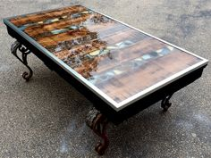 "Decorative 48""x 28"" Coffee Table created with the use of a Pallet, broken pieces of Ceramic Tile, repurposed metal legs from a different Coffee Table, Epoxy coating top and galvanized edging."