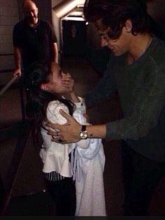 awww(: i read a story about this on twitter. this little girl was crying at soundcheck, so Harry kept trying to make her smile, but she wouldn't stop crying. after the soundcheck, Harry asked security to bring the little girl and her sister backstage and he surprised them and chatted with the little girl for a while and took pictures with her(: what a sweetheart<3 -DC