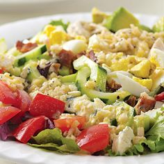This Cobb salad is true to the original with all the good stuff�chicken, eggs, bacon, avocado and a tangy dressing. But we cut the saturated fat in half and doubled the amount of healthy monounsaturated fat. We've left the blue cheese optional, but the salad is so nutritious you might just want to go ahead and indulge yourself with a little bit anyway.