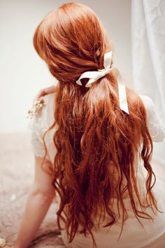 Long, wavy red hair