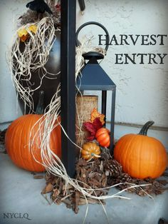 When styling a Harvest Entry for Fall, I love using metal lanterns from  #HomeGoods - I just remove the glass to make it easier to style with mini gourds, leaves, moss, woodchips and pinecones | #HappyByDesign Lynda Quintero-Davids #FocalPointStyling