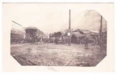 Miners leaving the train at Coal Creek mine, approx. 16 km from Fernie, c.1904-1920s.