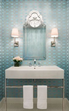 I love the combination of the clean geometric lines of the wallpaper, vanity and sconces with the more ornate mirror and chandelier. {design :: martha o'hara}: