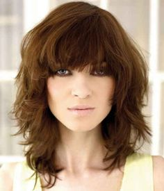 Layered hair with bangs.