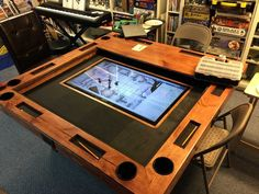 Build a gaming table for $150, plus the cost of an LCD TV for digital game boards. WANT.