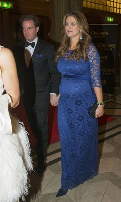 Chris O'neill and Princess Madeleine looks vibrant in royal blue lace dress.  It is simple yet elegant.