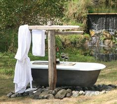 OUTDOOR BATHS | Waterfall Lodge at Wainui Country Retreat - Totaltravel