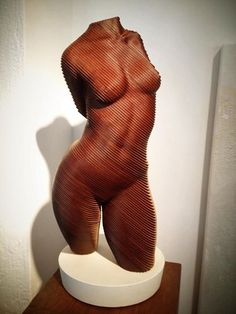 This amazing wooden torso is made by olivier duhamel and for sale in art 9 gallery.