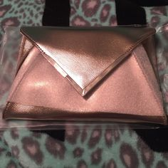 Rose Gold Lancôme clutch/makeup bag Rose Gold Lancôme clutch/makeup bag. Brand New. Never used. Still has wrapping. Lancome Bags Clutches & Wristlets