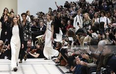 Models present creations during the Burberry Prorsum spring / summer 2016 collection show at London Fashion Week in London on September 21, 2015. AFP PHOTO / JUSTIN TALLIS