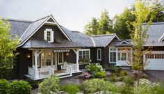 This dreamy Muskoka Lake house comes with a beautiful boat house designed with plenty of space for guests.