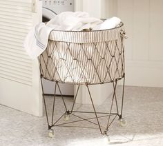 I got this french laundry basket second-hand and made a liner for it. Pretty to look at fun to roll to laundry room.