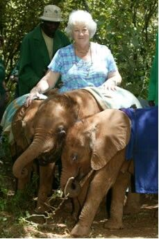 Daphne Sheldrick with three rescued baby elephants