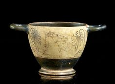 A WHITE-GROUND SKYPHOS, IN THE MANNER OF THE 5TH CENTURY B.C. ATTIC PRODUCTIONS