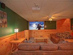 "Wilderness Theater & Lodge - Sit back and relax watching your favorite movie in front of the 100"" High Definition Home Theatre with Surround Sound and Blue Ray. Equipped with a popcorn machine to make it a true theatre experience, in the comfort of your cabin."