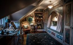 The eccentric Artist's Studio, tucked under the eaves, has a cabin bed, and gives visitors the sense they're staying in the attic room of an eccentric artist.