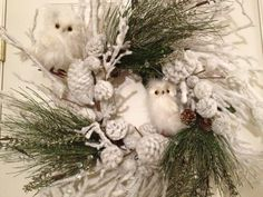 frosted twig wreath with owls. from Freckled Wreaths via Etsy.