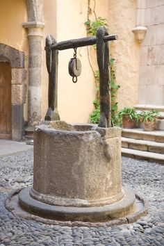 Photo about Vintage water well in a medieval village in Spain. Image of ancient, stone, wishing - 3399473 Old Water Pumps, Gazebos, Wheelbarrow Garden, Water Well, Wishing Well, Le Moulin, Make A Wish, Water Features, Fountain