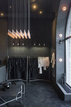 retail interior, triangular flooring, bulb installation | PODOLYAN Store Project / FILD design thinking company