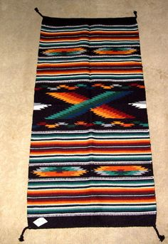 """Bring some color into your home with this quality handwoven wool rug! 32x64"""" w/ tassled corners Durable enough for everyday traffic, but SO pretty you might just want to hang it on your wall. $79.95 #rug #tapestry #throwrug #southwestern #homedecor"""