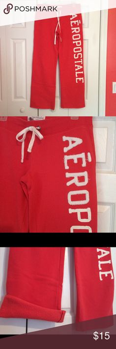 Aeropostale Sweatpants Boyfriend sweats, Straight Leg Sweat Pants, Soft, Fleece.  Drawstring waistband.  Coral color, white block letters.  Half the letters have a soft, 3-D, fuzzy texture (some fringes have gotten longer) and the second half are a smooth print (some are intentionally distressed looking). Inner lining is fleece. In very good condition. Aeropostale Pants