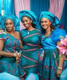 Blue/pink/green Ankara print fabric sewn into different styles