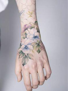Hydrangea hand tattoo by Silo - Top 10 Cities to Get Tattooed In Symbol Tattoos, Body Art Tattoos, Sleeve Tattoos, Side Tattoos, Foot Tattoos, Tatoos, Hand Tattoos For Women, Tattoos For Guys, Back Tattoo