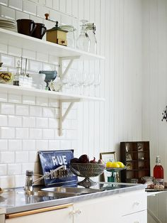 I like the white subway tile with the white cabinets - hoping to do that in our kitchen soon