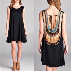 TENDERLY sleeveless jersey dress - BLACK How beautiful is this back design! COLOR BLOCK CROCHET PATCH BACK WITH SPAGHETTI TIE SLEEVELESS SWINGY HEM SOLID JERSEY DRESS Fabric 96% RAYON 4% SPANDEX  AVAILABLE IN BLACK AND ROYAL BLUE.  NO TRADE, PRICE FIRM Bellanblue Dresses Midi