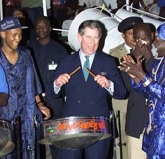 Music man: Prince Charles tries his hand at the steel drum while visiting the Renegade Pan Yard on a visit to Port-of-Spain in Trinidad in 2000