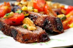 Rib-Eye Steak with Warm Tomato Corn Salad. [replacing corn with baby spinach]