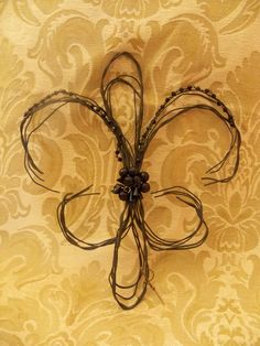 Wire Fleur De Lis Wall decoration. $30.00, via Etsy. Bling it up a notch to perfect!