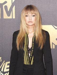 Gigi Hadid's faux fringe, nude lips and defined eyes at the 2016 MTV Movie Awards.