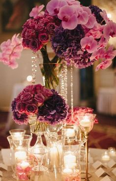 Purple and pink wedding reception centerpiece idea; Featured Photographer: Judy Pak Photography