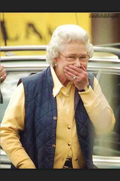 Her Majesty can't stifle a laugh