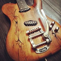 Wooden finish guitar by Throne pedalboards