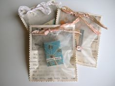 these little bags below are made from storybook pages and wax paper  the ribbon at the top is from silk saris  the sari fabric has been recycled by tearing it into strips of ribbon