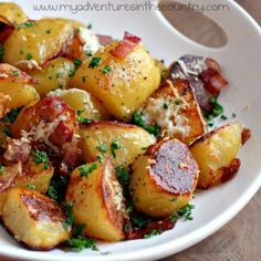 INGREDIENTS:  1 Tbsp olive oil   1/2 lb hickory smoked, thick sliced bacon   3 1/2 lbs Yukon Gold Potatoes   2 cloves garlic, minced   1/4 cup Parmigiano-Reggiano freshly grated   Coarse salt  Fresh gound pepper fresh parsley